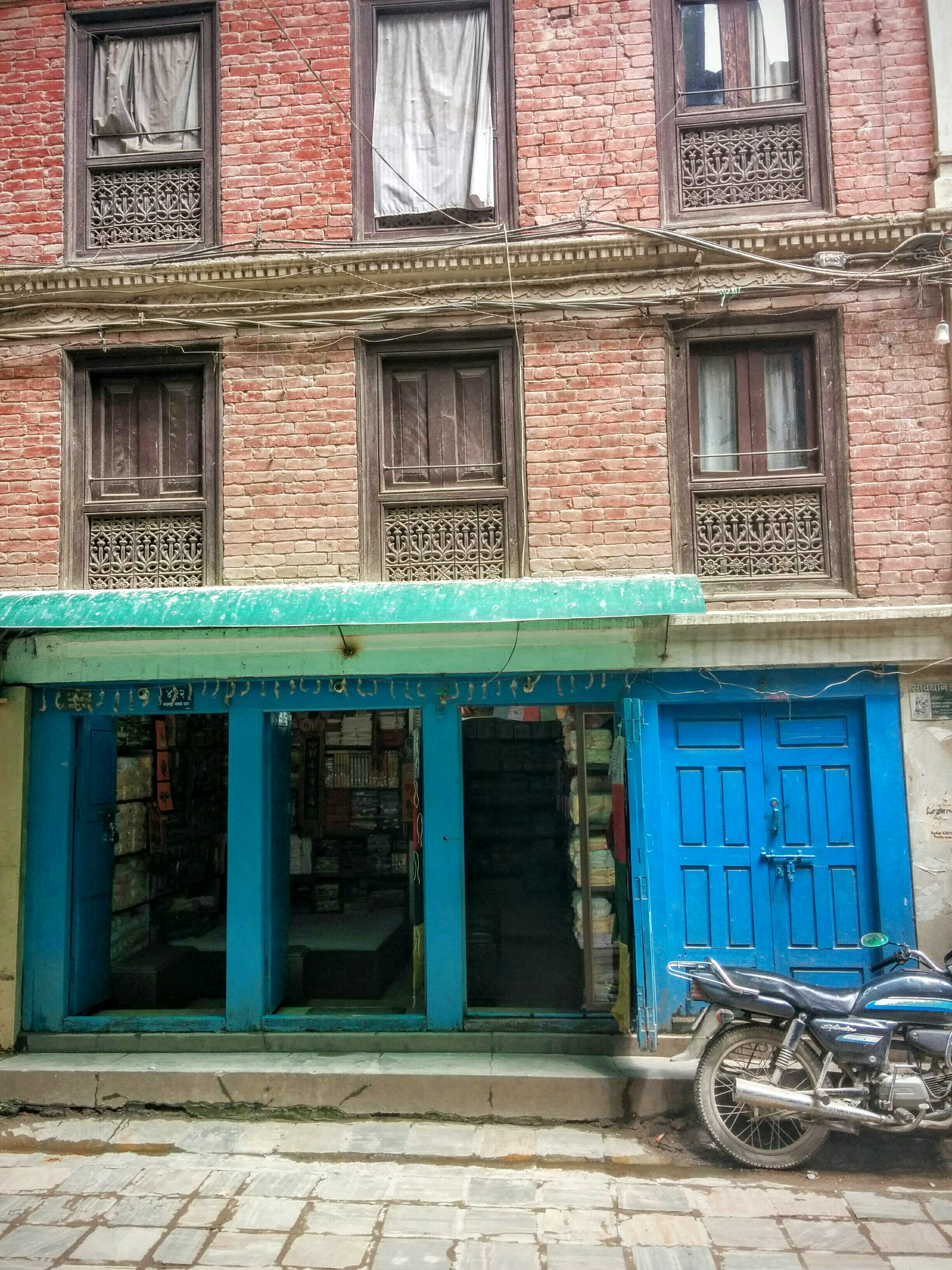 The front of a simple shop in an older building