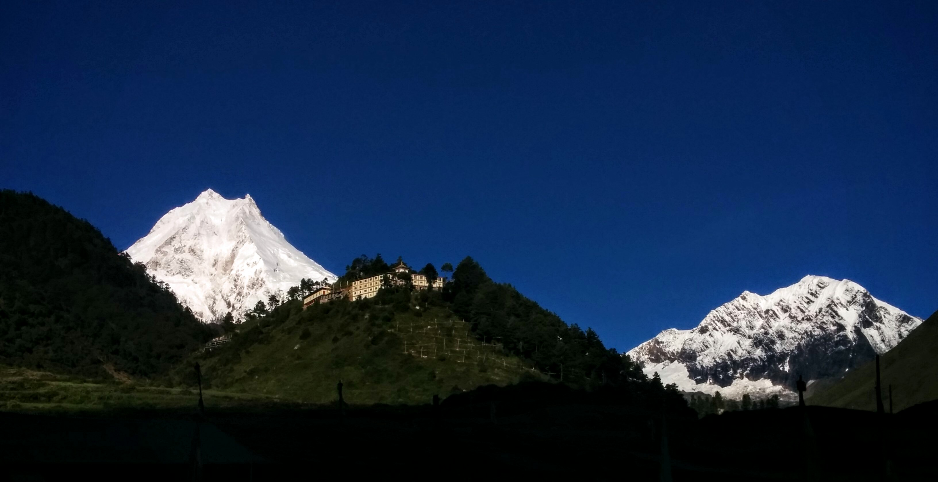 Manaslu on the left, silhouetted by the monastery in Lho